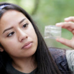 Students test water at Chicopee Lake.