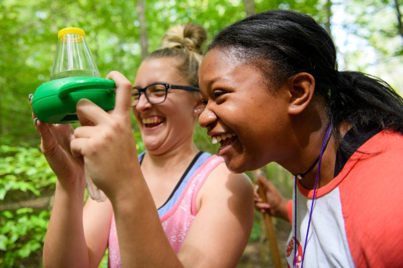 Two students test water.
