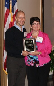 Dr. Mary Shotwell, presenting the GOTA Outstanding Student Award to Marco Coelho, a Norcross Weekend student