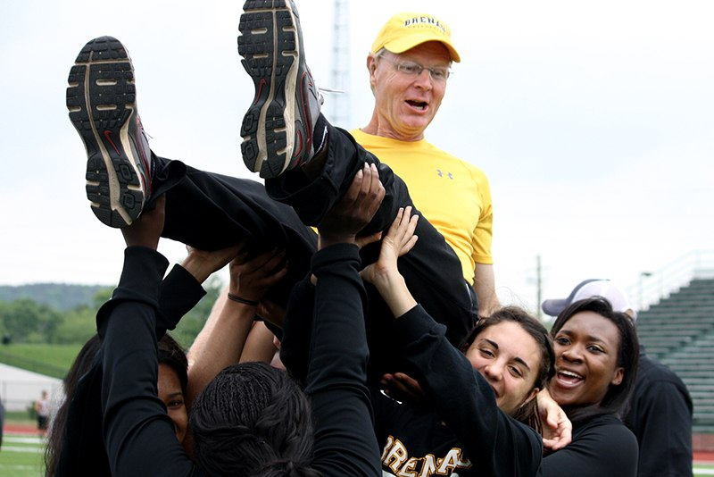 Brenau's track and field coach, Richard Ludwig, is hoisted into the air by the Brenau ladies after they won the SSAC Championship Saturday, April 27 and Shorter University in Rome, Ga.