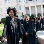 Jasmyn Farmer, left, holds hands with other members of the class of 2013 as they walk to the Crow's Nest on the front lawn of Brenau University's historic Gainesville campus during the Class Day event of the Alumnae Reunion Weekend Saturday, April 13, 2013.