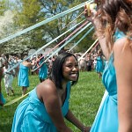 Mycharia Spurling, center, works her way around the May Pole on the front lawn of Brenau's historic Gainesville campus during the May Day festivities of Alumnae Reunion Weekend Saturday, April 13, 2013.