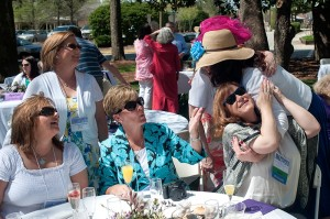 Kelley McHam Carlisle, right, recieves a hug from her friend Renee Loggins during the brunch and champagne toast portion of the Alumni Reunion Weekend Satuday, April 13 on Brenau University's historic Gainesville campus.