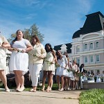 From left, Women's College juniors Jessica Anderson, Hannah Scheel, Anna Claire Dover, Amber Durden, Amber Boyd, Katey Kibler and Jackie Willis carry the ivy chain from Brenau's fountain to the Crow's Nest during the Class Day portion of Alumnae Reunion Weekend.