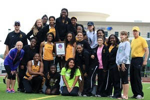 The Brenau Track and Field team poses for a portrait after winning the SSAC championship.