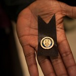 James Armooh displays his pin from the Brenau University School of Nursing. Each nursing school has a pin that is unique so their graduates can remember the hard work, struggles and bonds created during their time as a nursing student.