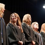 Fromt left, Amy Sedgwick, Brandy Perry, Joni Quinlan, Jennifer Cawthorn, Caroline Larson and Derick McConnell stand on stage in Brenau University's Pearce Auditorium during the nursing school's pinning ceremony.