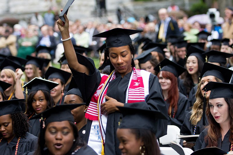 Pytron Parker raises her hands as she stands up during the commencement exercises on the front lawn of Brenau University's Gainesville campus. On Friday the graduating 2013 Women's College students walked across the stage and received their diplomas in front of faculty and staff, their friends and family.
