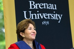 Brenau University commencement speaker Anne-Marie Slaughter smiles as University President Ed Schrader introduces her. Slaughter advised the graduating class to follow their hearts and do what they want to do, not what they don't want to do.