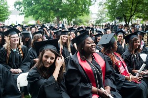Shantél Francis, center, smiles after she and the rest of the 013 Brenau University Women's College graduates moved their tassels across their hats signifying they have graduated.