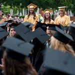 Katelin Mize, Ellen Peterson, and Abigail Umberger stand and are recognized as the last graduates earn a high school diploma through the Brenau University Early College Program.