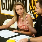 Lauren Smith, left, looks to Brenau University Golf Coach Damon Stancil as she signs her scolarship to play golf at Brenau University.