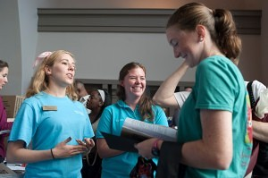 Cassey Wyatt, center, laughs as she and fellow Rho Gamma Savannah Long explain different sorority options to incoming freshman at Brenau in the John S. Burd Center for the Performing Arts during move in day. The Rho Gamma's shed their Greek letters and affiliations from move in until rush to help the girls find a sorority in an unbiased way.