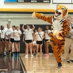 The Brenau University mascot H.J. looks to throw out T-shirts during Thursday's pep rally in the fitness center.