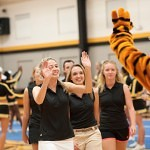Brenau University Golf Team member Kelly Garland goes for a high-five from GOlden Tiger mascot H.J. during Thursday's pep rally.