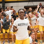 Linda Chukwuji reluctantly walks up to volunteer for the dance competition during Thursday's pep rally as the rest of her Brenau University Soccer teammates cheer her on.