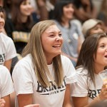 Courtney Deason laughs with the rest of the Brenau University Volleyball Team during the dance competition at Thursday's pep rally.