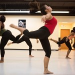 Brenau University's Amanda Bonilla, center, performs a piece of Merce Cunningham choreography with a select group of students during the Day of Dance program at the Fitness Center.
