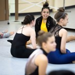 "Amanda Bonilla, a Brenau University dance student, talks with high schoolers during this years Day of Dance event at Brenau University.    ""It's extremely essential to have (our) students there,"" said Casandra Alvarado, a visiting assistant professor of dance at Brenau. ""Whenever I was looking for colleges when I was younger, It's kind of nerve racking just talking to faculty and adults. Our students are more on their age level and can really talk to them about what the college dance experience is really like."""
