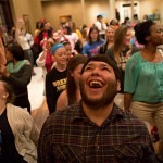 Cody Otero, center, dances with members of the Women's College during Midnight Breakfast in the Yonah Dinning Hall, Thursday, Nov. 21, 2013.