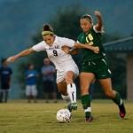 Brenau's Elizabeth Campbell fights for possesion against Belhaven's Jordan Organ during Thursday's match.