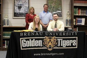 Sarah Bowers, bottom left, signs her letter of intent with Brenau University as she sits next to the university's head golf coach Damon Stancil and her parents, Cindy and Clark Bowers, watch on.