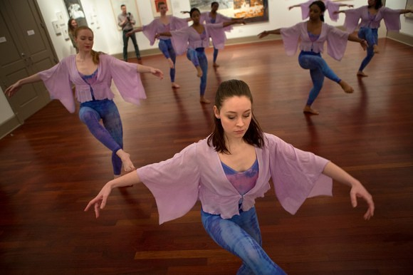 Emily Lemons, a dance studies sophomore at Brenau University, performs a piece of Merce Cunningham coreography surrounded by work from artists such as Robert Rauschenberg and Jasper Johns in the Castelli Gallery at Brenau University.
