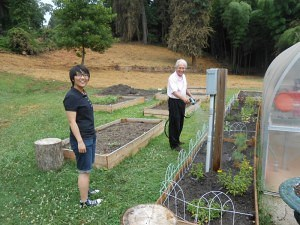 Autumn Zhao (Graduate Student, Int.Design) and Dr. Vince Yamilkoski work on the herb garden.