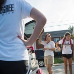 Debbie Kosater, center, helps her daughter Madison, right, unload the car during move in day on Brenau's Gainesville campus.