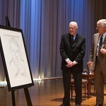 President Carter admires Brenau University's portrait of Jimmy Carter from 1977 done by Andy Warhol.