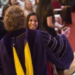 Fatima Heravy receives a hug from Dr. Suzanne Erickson after earning the Outstanding Business Student Award.