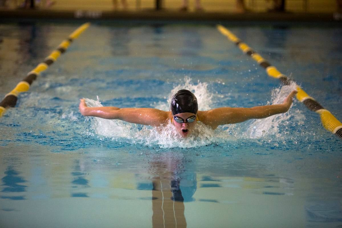 Shelby Rumker competes in the women's 50 butterfly during a swim meet at Brenau with Columbia College, Berry College, Thomas University and Life University