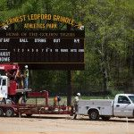 Crew members from Masstar Signs begin to pack up after assembling the scoreboard for the Brenau softball team on Tuesday, April 5, 2016 at the Ernest Ledford Grindle Athletics Park in Gainesville, Ga. (AJ Reynolds/Brenau University)