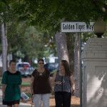 Pedestrians make their way past the sign for Golden Tiger Way during a pep rally and dedication ceremony for Golden Tiger Way on Thursday, April 21, 2016, in Gainesville, Georgia. (AJ Reynolds/Brenau University)