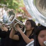 Paolo Avila, center, and Reyna Cisneros perform with the Golden Tiger Band during a pep rally and dedication ceremony for Golden Tiger Way on Thursday, April 21, 2016, in Gainesville, Georgia. (AJ Reynolds/Brenau University)