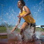 Brenau's Jasmine Ray hits the water jump in the 3000m steeplechase during the final day of the SSAC Outdoor Track & Field Championship on Saturday, April 23, 2016, at the Jaguar Track at the University of South Alabama in Mobile, Ala. Brenau won the 2016 SSAC Women's Outdoor Track & Field Championship. (AJ Reynolds/Brenau University)