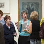 Nancy HIll and Anne Chenault chat with patrons during the John Heliker 'The Order of Things' opening at the Sellars Gallery on Brenau's historic Gainesville campus.