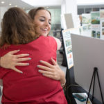 Macy Dwyer, Bachelor of Fine Arts/Master of Interior Design graduate, hugs Heidi Plumb, Master of Fine Arts in Interior Design graduate, during the M.F.A./M.I.D. Portfolio Exhibition at the High Museum of Art on Thursday, June 16, 2016, in Atlanta, Ga. (AJ Reynolds/Brenau University)