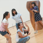 Cathy Wu snaps a photo inside the High Museum of Art while, from left to right, Crsytal Wang, Lynn Lu and Lavender Qin look on.