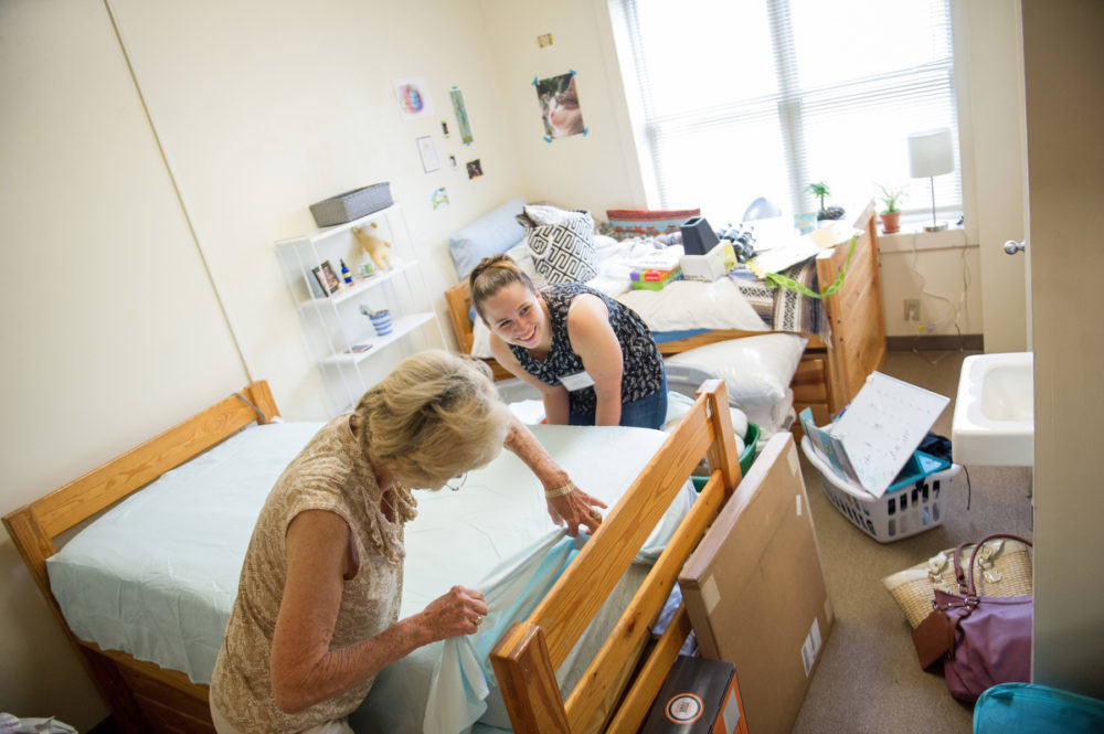 Cassidy Buck, a freshman special education major and dance minor, works with her grandmother Phyllis 'Mama' Engebretson to make up her room inside Van Hoose Hall. (AJ Reynolds/Brenau University)