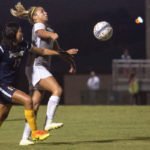 Alexis Satterfield, a freshman from Dawsonville, Ga., controls a ball ahead of a Point defender during a soccer game against Point University. Brenau won 4-0. (AJ Reynolds/Brenau University)