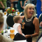 Carol Obermeyer Nall reacts while holding her granddaughter Kendall Nall. (AJ Reynolds/Brenau University)