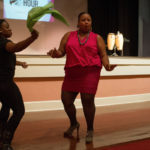 Shanik Moore dances with Valerie Simmons-Walston during a performance of the Tau Sigma Dancers during GRRRL PowHER HOUR. (AJ Reynolds/Brenau University)
