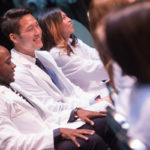 From left to right, Lesly Devliere Jr., Jason Chong, and Joanna Chen react after receiving their white coats during the White Coat Ceremony for the Brenau University Doctorate of Physical Therapy Class of 2019. (AJ Reynolds/Brenau University)