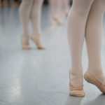 Dancers stand on their toes during a ballet class. (AJ Reynolds/Brenau University)