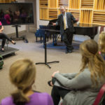 Brazilian Deputy Consul Guillermo Rivera visits a class for a performance of Brazilian music by the Brenau Vocal Chamber Ensemble
