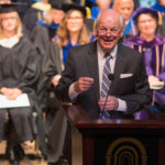 Pete Miller, chairman of the Brenau Board of Trustees, gives a welcome and introduces Dr. Schrader's commencement address during the graduate commencement ceremony. (AJ Reynolds/Brenau University)