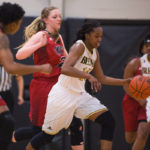 Briah Woods, a senior forward from Acworth, Ga., dribbles around defenders during a Brenau Golden Tigers Basketball game against William Carey University. Brenau won 68-64. (AJ Reynolds/Brenau University)
