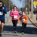 From left to right, Froylan Diaz, Alison Toller, Caleb Richey and Graham Reaves cross the finish line during the Dempsey Dash 5K, a race celebrating the memory of Brenau's longtime Executive Vice President and CFO Wayne Dempsey, on Saturday, March 11, 2017. (AJ Reynolds/Brenau University)