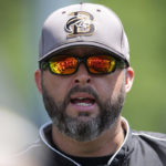 Brenau head coach Devon Thomas motivates players before Brenau women's softball takes on College of Coastal Georgia in Southern States Athletic Conference (SSAC) at Ernest Ledford Grindle Athletic Park, Friday, April 21, 2017. Brenau defeated Coastal 2-1. (Photo/ John Roark, for Brenau University)